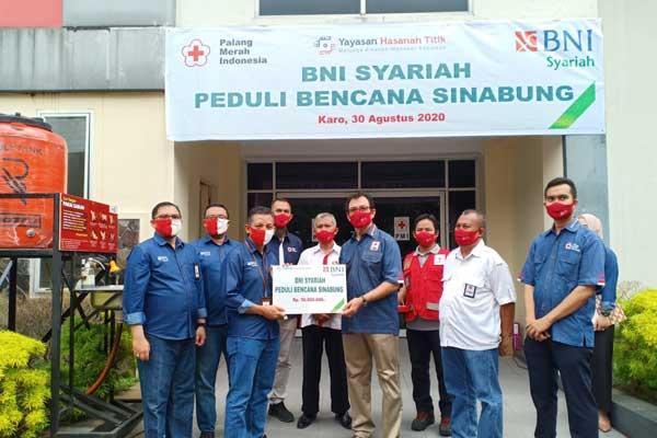 DISTRIBUSIKAN: BNI Syariah dan PMI Sumut salurkan bantuan senilai Rp 50 Juta? ke Kabupaten Karo.